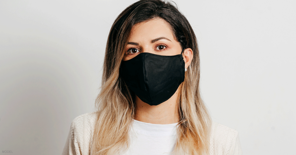 Woman in a mask with youthful and refreshed eyes