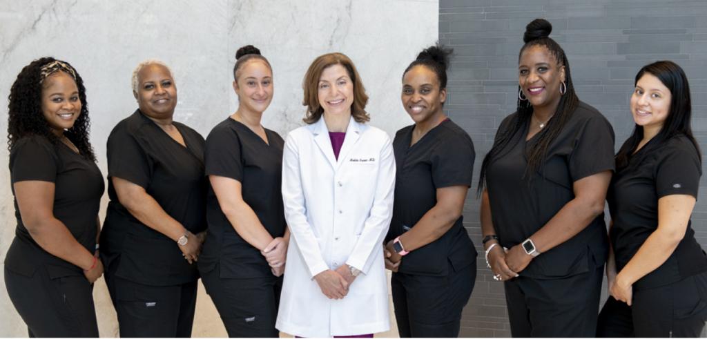 The MI Skin team, including Dr. Melda Isaac